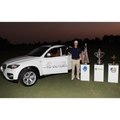 Martin Kaymer, German winner of a Major tournament and BMW Golfsport ambassador, with trophies after his victory of the Race to Dubai in the local desert (11/2010).