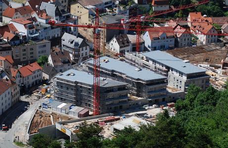 Auf einer Gesamtfläche von 14.000 m² wurden fünf moderne Stadthäuser mit 91 überwiegend barrierefreien Eigentumswohnungen errichtet, Foto: Caparol Farben Lacke Bautenschutz/Achim Zielke