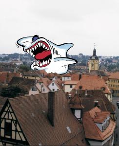 """Der """"Dach-Hai"""" ist zur Symbolfigur für maßlos gierige und skrupellose Dachhandwerker geworden, denen schnelles Geld vor guter Arbeit geht."""