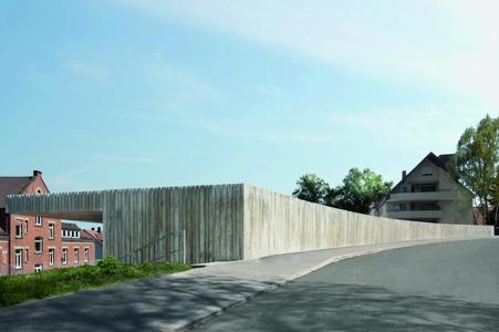 Von der Straße aus gesehen, zeigt sich der Schulneubau mit seiner schalungsrauen Betonfassade. Der Ziegel-Altbau steht der Vorderseite des eingeschossigen Neubaus gegenüber