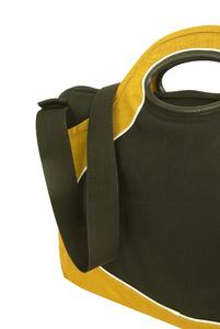 Adjustable and removale shoulderstrap, stretchy pocket on the front and two handles with snap botton closing