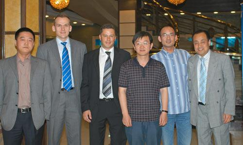 The photo shows (l-r): KBA China's Zhao Lin and Andreas Friedrich, KBA Asia-Pacific managing director Stefan Segger, Zhejiang Daily project manager Cai Ru Song and technical director Du Pionjiang, and KBA China's Han Shao Sheng (9)