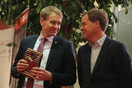 Ministerpräsident Günther und Oberbürgermeister Dr. Ulf Kämpfer