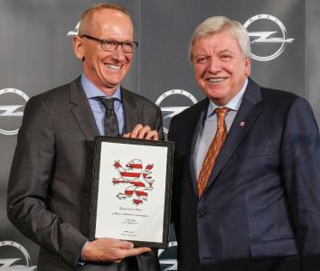 "Hesse's Prime Minister Volker Bouffier presents the ""Hessian Lion"" to Opel CEO Dr. Karl-Thomas Neumann on the occasion of the inauguration of the new Global Propulsion Systems Center in Rüsselsheim"