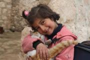 Sara* 6 and her cat, Western Aleppo, Syria