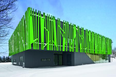 Der dunkle, carbonfaserverstärkte Putz an der Fassade des Kindergartens im österreichischen Sighartstein kontrastiert wirkungsvoll das helle Grün der Halme und betont deren Mittlerfunktion zwischen Innen- und Außenwelt