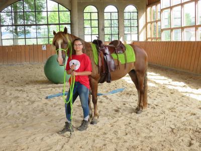 Reiterwoche Teilnehmerin mit Pferd