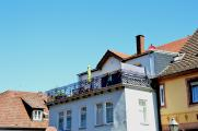Der Balkon auf dem Dach bringt Urlaubsfeeling pur für zuhause.