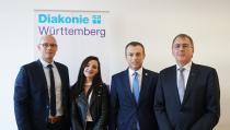 (von links): Johannes Miller, Qendresa Ptqaj, Arbeits- und Sozialminister Skender Reçica und Oberkirchenrat Dieter Kaufmann