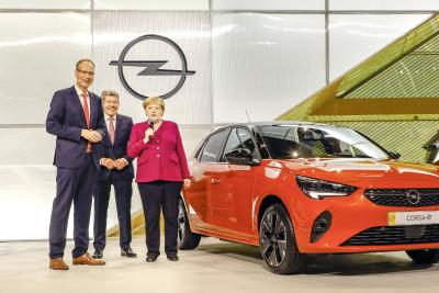 Chancellor Angela Merkel Visits Opel Stand at IAA