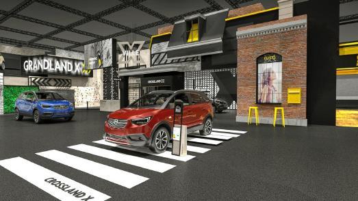 """Willkommen in """"X-Ville"""": Der Opel-Stand auf der IAA in Form einer kleinen Stadt namens – gesprochen – """"Crossville"""" lädt die Besucher zu Weltpremieren und vielen Aktivitäten ein"""