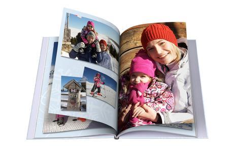 Gelungene Aufnahmen vom Winterspaß lassen sich auf den Seiten eines CEWE FOTOBUCHs festhalten