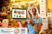 Blumenfee Maren Hellwig mit Laptop Shop + Testsieger