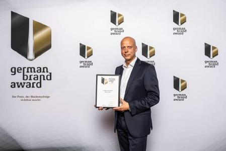 STIEBEL ELTRON Marketingleiter Claus Kroll-Schlüter freut sich über die Auszeichnung mit dem German Brand Award