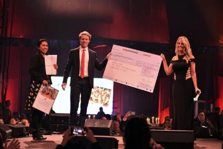 Juliana Gößmann, Christoph Hilligen from World Vision and Vicki Sorg from PM International announce the donation sum for 2019