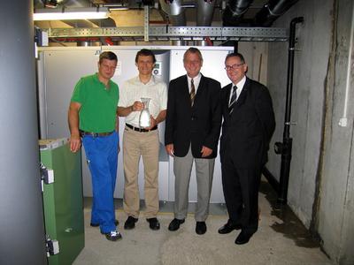 Von links nach rechts: Andreas Egloff, Michael Eser (Pacovis AG), Anselm Hagenbuch und Jürg Frutiger (AEW Energie AG)